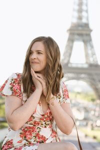 Real talk with Caitlin Ball, posing in front of the Eiffel Tower