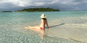 Bad Body Image, women sitting alone on a beach